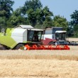 Combine harvester working on a wheat field — Stock Photo
