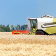Combine harvester working on a wheat field — Stock Photo #29658389