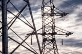 Electricity transmission towers — Stockfoto