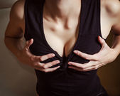 Girl holding her breasts. Closeup — Stock Photo