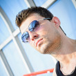 Royalty-Free Stock Photo: Fashion shot: closeup portrait of handsome young man wearing sunglasses