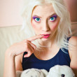 Closeup portrait of cute blonde girl with rabbit and tiger toys — Stockfoto