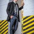 Fashion shot: handsome young man wearing jeans and coat — Foto Stock