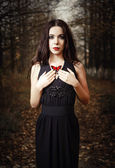 Beautiful girl holds red butterfly in hands. Outdoor portrait — Stock Photo