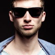 Portrait of handsome young man wearing sunglasses. Closeup — Stock Photo #45762573