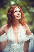 Closeup portrait of a beautiful redhead elf woman — Stock Photo