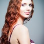 Closeup studio portrait of pretty redhead woman. Half-turned — Stock Photo #51059773