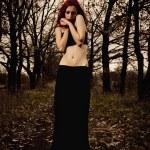 Portrait of beautiful young sad girl among the autumn trees — Stock Photo #7688667