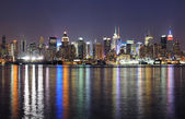 New York City Manhattan midtown skyline at night — ストック写真