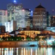图库照片: Montreal over river at dusk