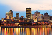 Montreal over river at sunset — Stock Photo