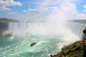Waterfalls and boat — Stock Photo