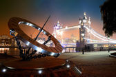 Sundial and Tower Bridge — Stock Photo
