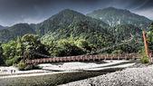 Myojin bridge and Azusa river in Kamikochi, Nagano, Japan — Stock Photo
