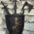 Medieval weapons on a background of ancient wall - Lizenzfreies Foto
