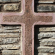 Cross on the background wall of medieval castle — Stock Photo