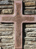 Cross on the background wall of medieval castle — Foto de Stock