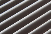 Semi-closed metallic blinds — Stock Photo
