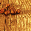 Coffee beans on the old wood background — Stock Photo