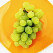 Bunch of grapes on a light background — Stock Photo