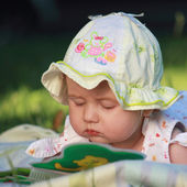 Baby is watching a book — Stock Photo