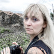 Blonde woman with camera — Stockfoto