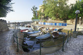 Boats in small fishing port — Stockfoto
