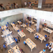 Stock Photo: Shoppers inside Apple store