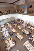Shoppers inside the Apple store — Stock Photo