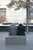 Senior couple remembering at 9-11 Memorial in New York City — Stock Photo