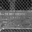 Stock Photo: No trespassing sign on fence