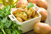 Baked potatoes with parsley — Stock Photo