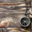 Wood texture with marine knot and compass — Stock Photo
