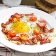 Stock Photo: Fried egg with bacon