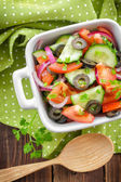 Salad with tomatoes and cucumbers — Stock Photo