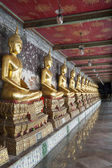Row of golden Buddha — Stock Photo