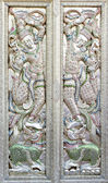 Ornate mosaic temple doors — Stock Photo