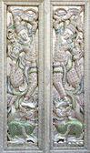 Ornate mosaic temple doors — Stock Photo