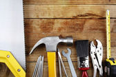 Assorted work tools on wood — Stock Photo