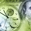 Clock and cash — Stock Photo
