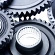 Stock Photo: Closeup of steel gears meshing together