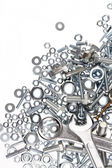 Wrenches, nuts and bolts on plain background — Stock Photo
