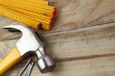 Hammer, nails and folding ruler — Stock Photo