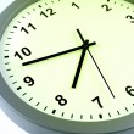Closeup of hands on clock face — Stock Photo