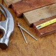 Assorted work tools on wood - Stockfoto