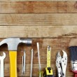 Assorted work tools on wood — Stock Photo #15633713