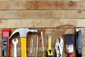 Assorted work tools on wood — Stok fotoğraf
