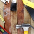 Stock Photo: Assorted work tools on wood