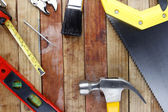 Assorted work tools on wood — Foto de Stock