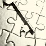 Key on puzzle — Stock Photo